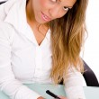 Businesswoman writing on pad — Stock Photo #1352166