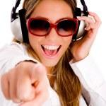 Pointing female enjoying music — Stock Photo