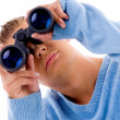 Stock Photo: Young mlooking through binocular