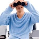 Professional looking through binoculars — Stock Photo #1352384