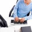 Young professional working on computer - Stock Photo