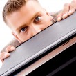 Professional man peeping from files — Stock Photo #1352392