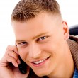 Handsome man talking on mobile — Stock Photo #1352400
