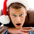 Guy with christmas hat looking at camera — Stockfoto