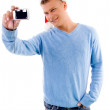 Guy posing with christmas hat and camera — Stock Photo