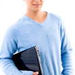 Smiling young man holding laptop — Stock Photo