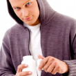 Young male holding medicine bottle — Stock Photo