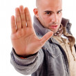 Young male with stopping hand gesture — Stock Photo