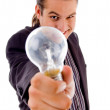 Young male holding electric bulb — Stock Photo