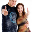 Royalty-Free Stock Photo: Young couple showing thumbs up