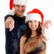 Christmas couple pointing at camera — Stock Photo #1353258