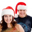 Brunette happy couple in christmas hat — Stock Photo #1353260