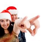 Christmas couple pointing away — Stock Photo