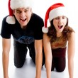 Christmas couple winking at camera — Stock Photo #1353270
