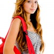 School girl posing with red bag — Stock Photo