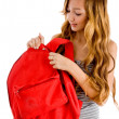 Curious student unziping bag — Stock Photo #1353366