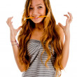 Teenager in excitment chewing pencil — Stock Photo #1353382