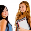 Students posing with study materials - Stock Photo