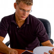 Manager looking into the documents — Stock Photo #1353597