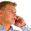 Handsome male talking on cell phone — Stock Photo