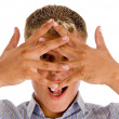 Male covering his face with hand gesture — Stock Photo