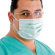 Close up of doctor with face mask — Stock Photo