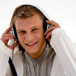 Young guy listening to music — Stock Photo #1354069