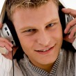 Close up of cool guy enjoying music - Stock Photo