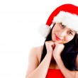 Beautiful young woman in christmas hat — Stock Photo #1354222