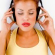 Female model tuned in music — Stock Photo
