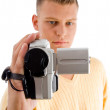 Young male with handy cam - Stock Photo