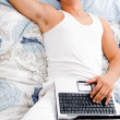 Man resting at his home with laptop — Stock Photo