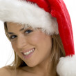 Smiling young lady with santa cap — Stock Photo