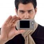 Young man holding digital camera — Stock Photo