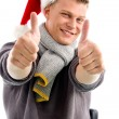 Christmas guy showing thumb up — Stock Photo