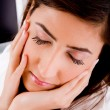 Closeup of tired woman with closed eyes — Stock Photo