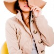 Stylish young female with hat - Stock Photo