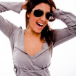 Woman with sunglasses holding her hair - Stock Photo