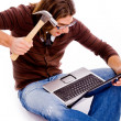 Angry male striking laptop — Stock Photo