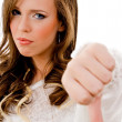 Young female with thumbs down — Stock Photo