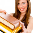 Smiling student showing books — Stock Photo