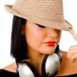 Female wearing headphones and hat — Stock Photo