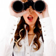 Shocked model looking through binocular — Stock Photo