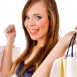 Smiling woman holding bags — Stock Photo