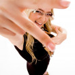 Smiling model showing hand gesture — Stock Photo #1357991