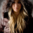 Woman wearing hood jacket — Stock Photo #1358076