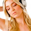 Stock Photo: Sensuous model listening music