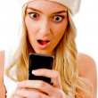 Surprised woman holding cellphone — Stock Photo #1358114