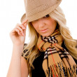 Woman holding her hat - Stock Photo
