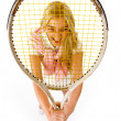 Smiling young woman with tennis racket — Stock Photo